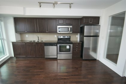 Designer Kitchen Cabinetry With Stainless Steel Appliances, Granite Counter Tops & Hardwood Flooring.