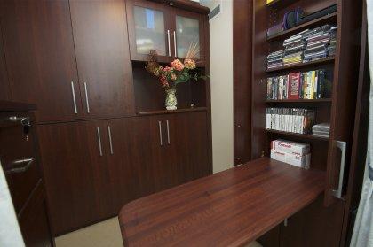 A Built-In Murphy Bed, Closet & Desk Area In Den Area.