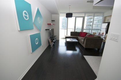 Suite Entrance With Upgraded Dark Hardwood Flooring Throughout The Living Areas.
