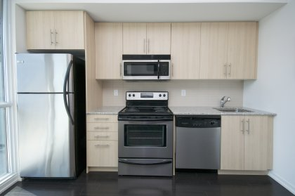 Designer Kitchen Cabinetry With Stainless Steel Appliances, Granite Counter Tops, Upgraded Undermount Sink & Dark Hardwood Flooring.