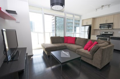 Spacious Sized Living Area With Upgraded Dark Hardwood Flooring Throughout The Living Areas Facing Unobstructed South Lake Views.