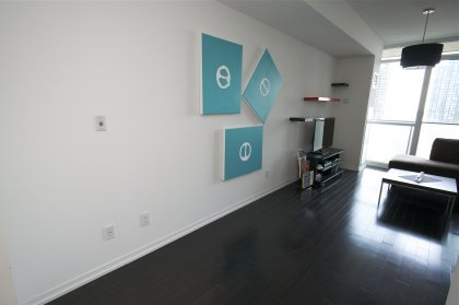 Study Area With Upgraded Dark Hardwood Flooring Throughout The Living Areas.