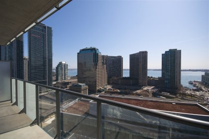 Large Balcony Facing Unobstructed Direct South Lake Views.
