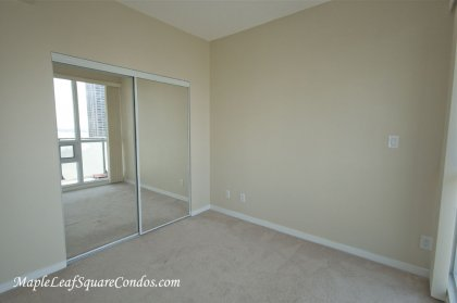 Spacious Sized 2nd Bedroom With Mirrored Closets Facing Direct Lake Views.