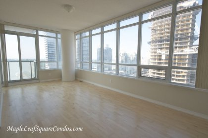 Open Concept Living & Dining Areas With Hardwood Flooring, Wrap Around Windows Facing Gorgeous C.N. Tower & Lake Views.