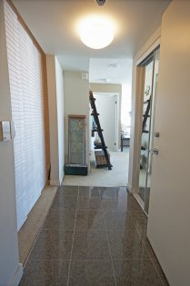 Front Foyer Entrance With Upgraded Granite Tiles & Mirrored Closet Doors.