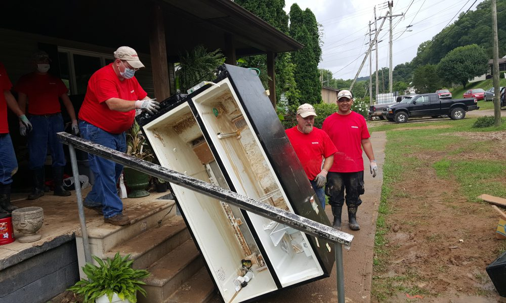 Elbow Grease: TMMWV Team Members Volunteer to Help Flood Victims Dig Out