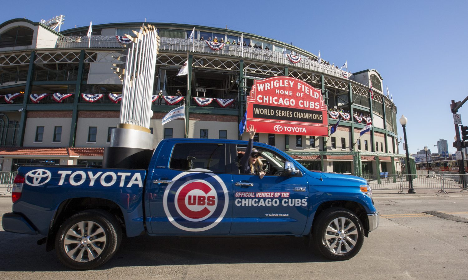 Toyota Tundra Carries Ten-Foot-Tall World Series Trophy During Cubs Victory Parade