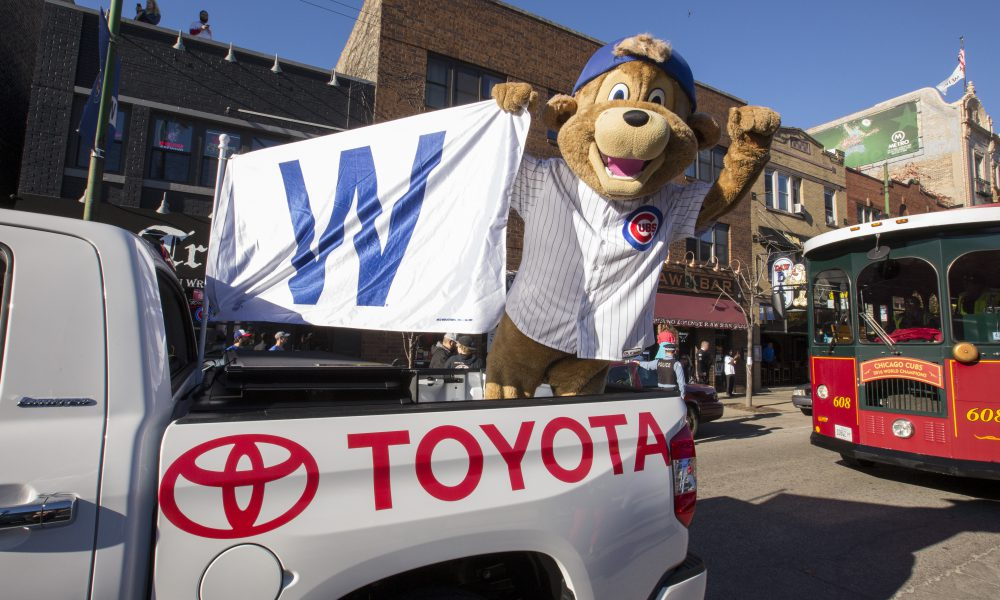Toyota Tundra Carries Ten-Foot-Tall World Series Trophy During Cubs Victory Parade 04