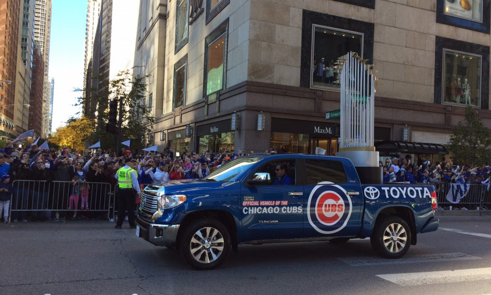 Toyota Tundra Carries Ten-Foot-Tall World Series Trophy During Cubs Victory Parade 01