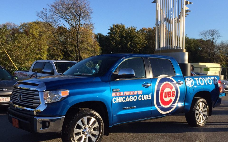 Toyota Tundra Carries Ten-Foot-Tall World Series Trophy During Cubs Victory Parade 02