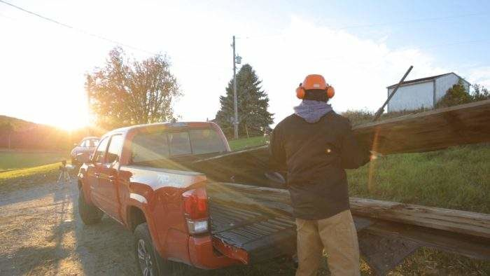 Sebastian Loading up The Tacoma with Barn board