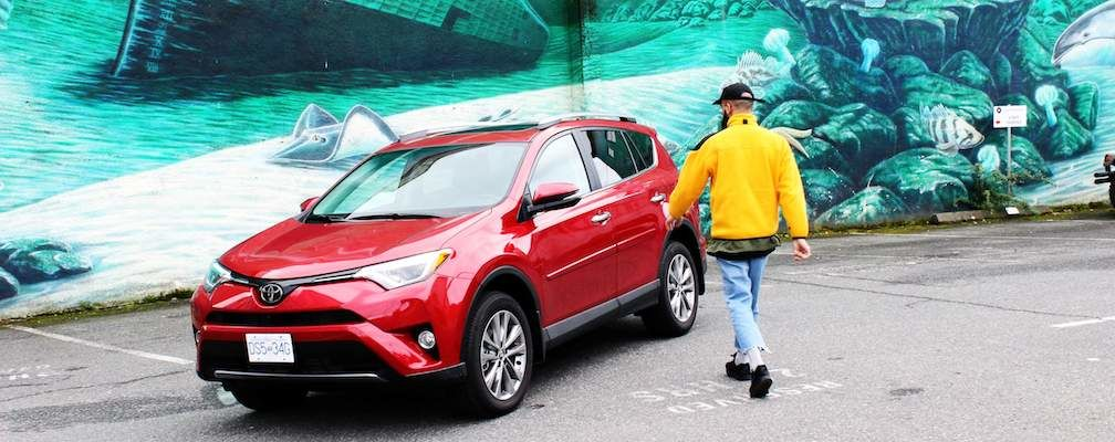 RAV4 in Red in front of Graffiti Wall