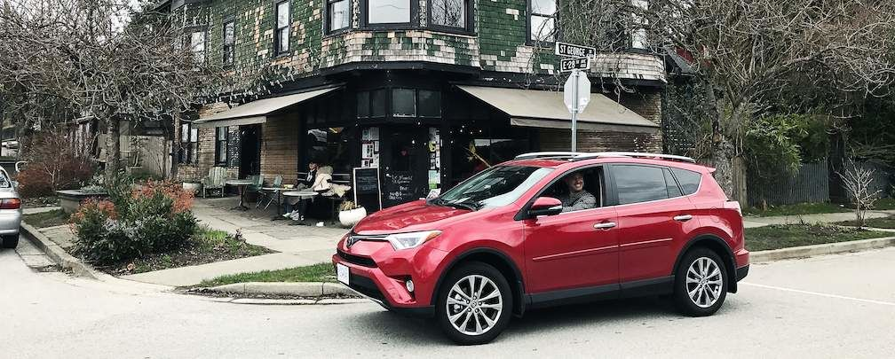 Red RAV4 at Intersection