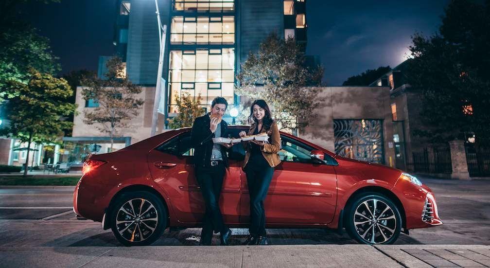 Couple Beside 2017 Corolla in Red