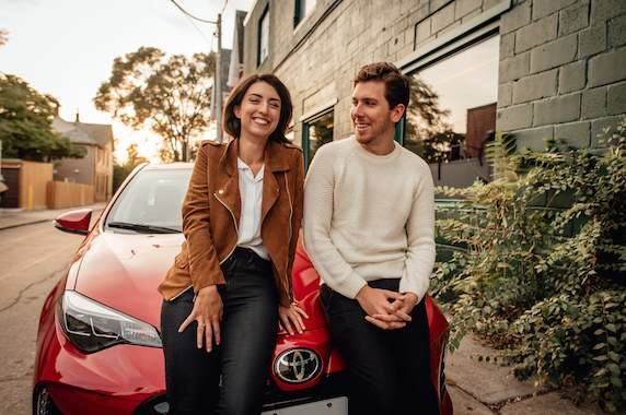 Couple in Front of Red Toyota Corolla 572