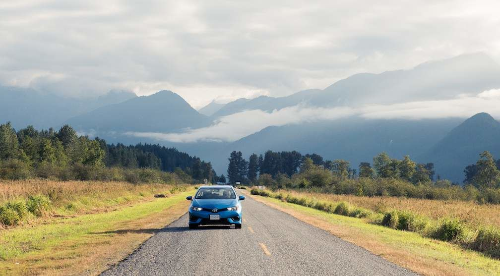 Corolla iM in Blue Driving Away From Mountains