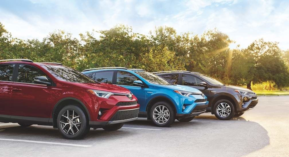 RAV4 SE in Ruby Flare Pearl. Hybrid Limited in Electric Storm Blue. Hybrid LE+ in Magnetic Grey Metallic