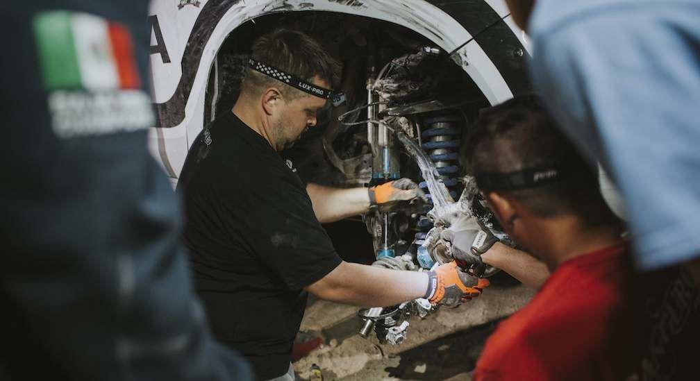Team doing maintenance on truck