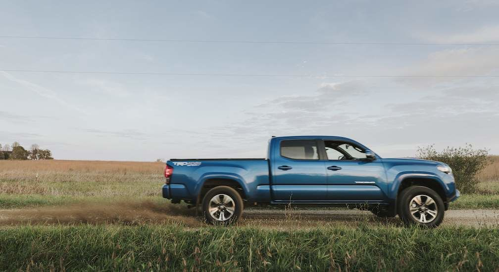 Toyota Tacoma in Blue Side View
