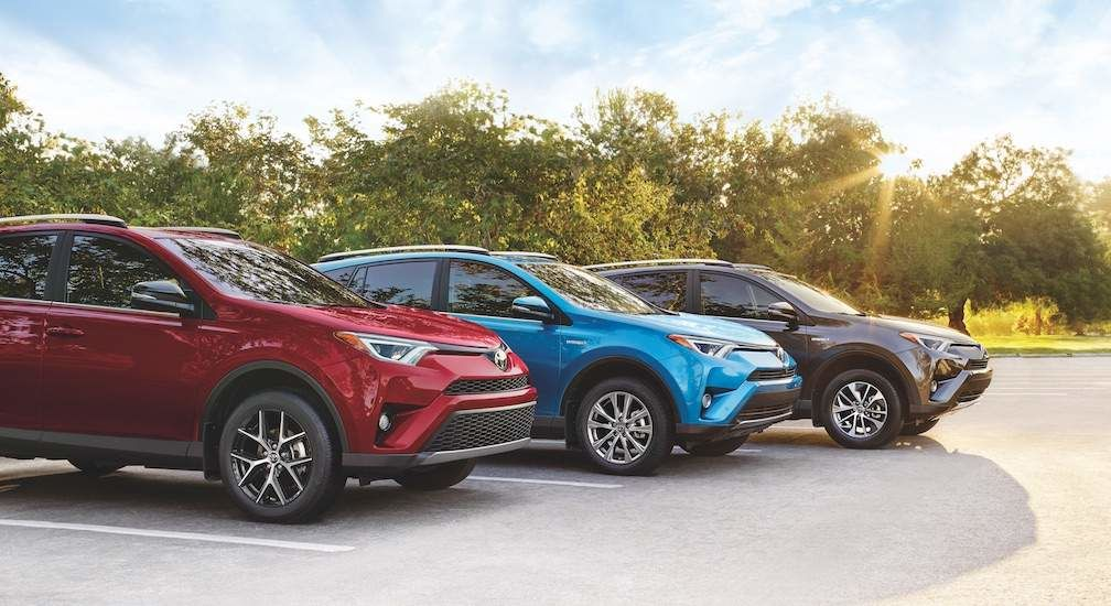 Rav4 SE in Ruby Flare Pearl Hybrid Limited in Electric Storm Blue. Hybrid LE+ in Magnetic Grey Metallic