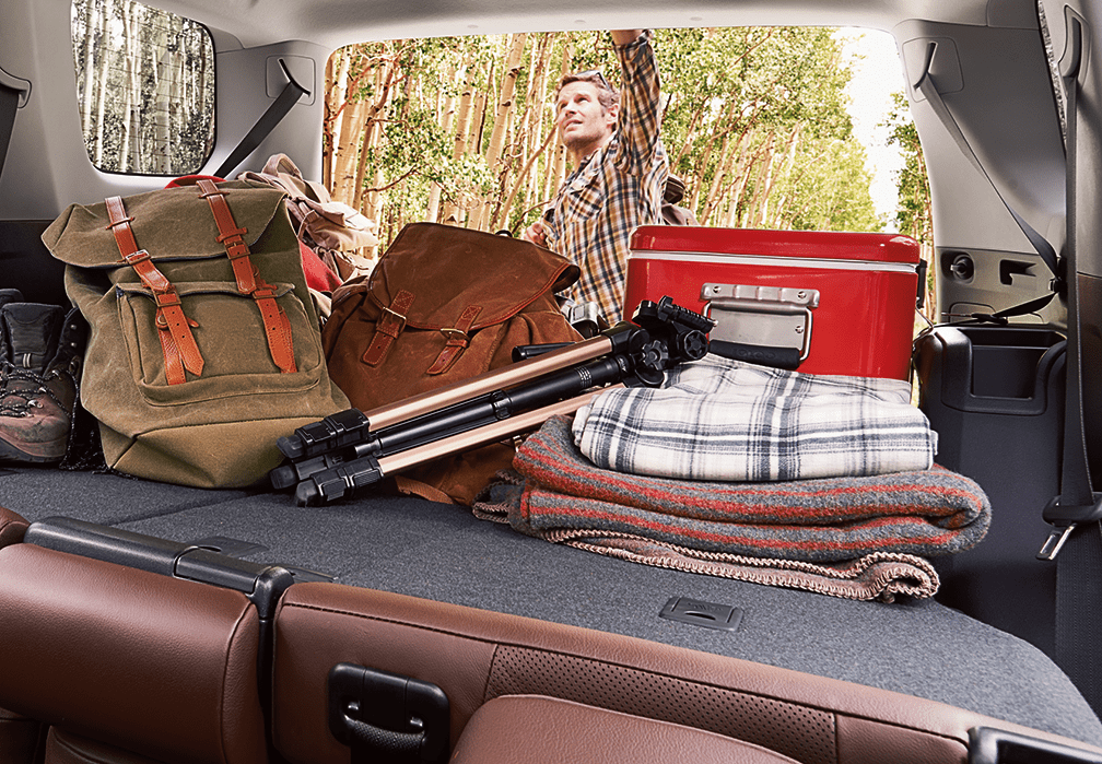 Blankets and pillows packed for a road trip.