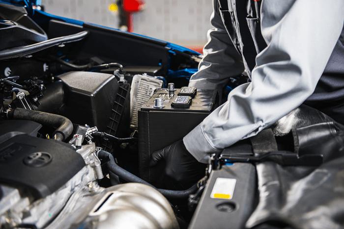 Technician installing a battery