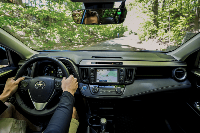 Dashboard view of the 2018 Toyota RAV4 Hybrid shown in Black SofTex.