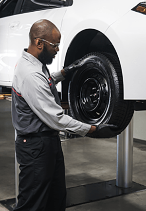 Toyota Parts & Services changing car wheel.