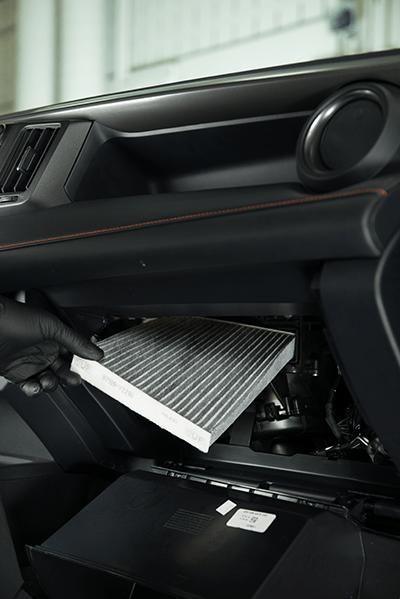 Toyota technician installing Cabin Air Filter