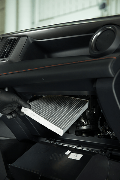 Toyota technician installing Cabin Air Filter