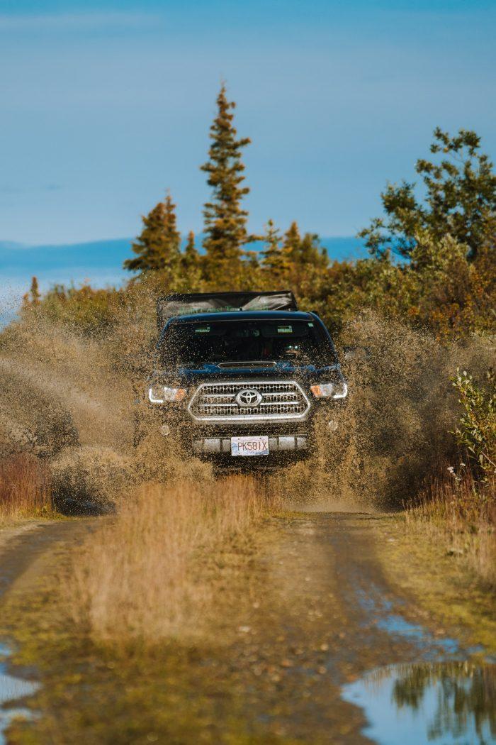 Toyota Tacoma off-road splash through water in the Yukon