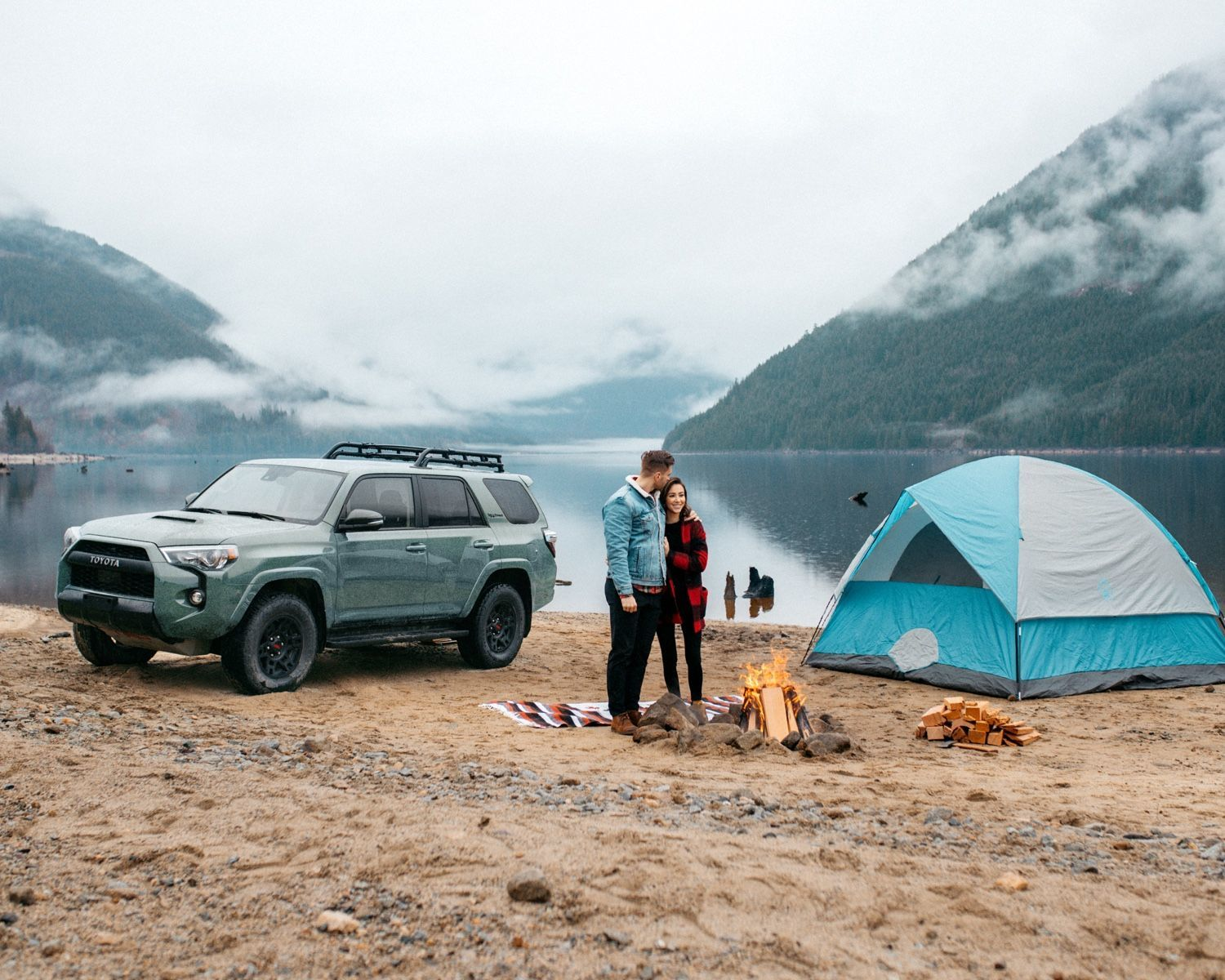 4Runner TRD Pro shown in Lunar Rock with a couple camping on a beach