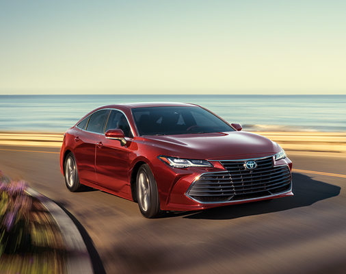 Avalon Limited AWD shown in Ruby Flare Pearl