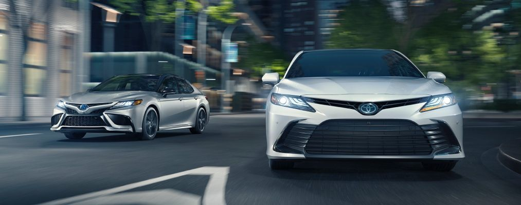 Camry Hybrid XSE shown in Celestial Silver Metallic with Black Roof and Camry Hybrid XLE shown in Wind Chill Pearl