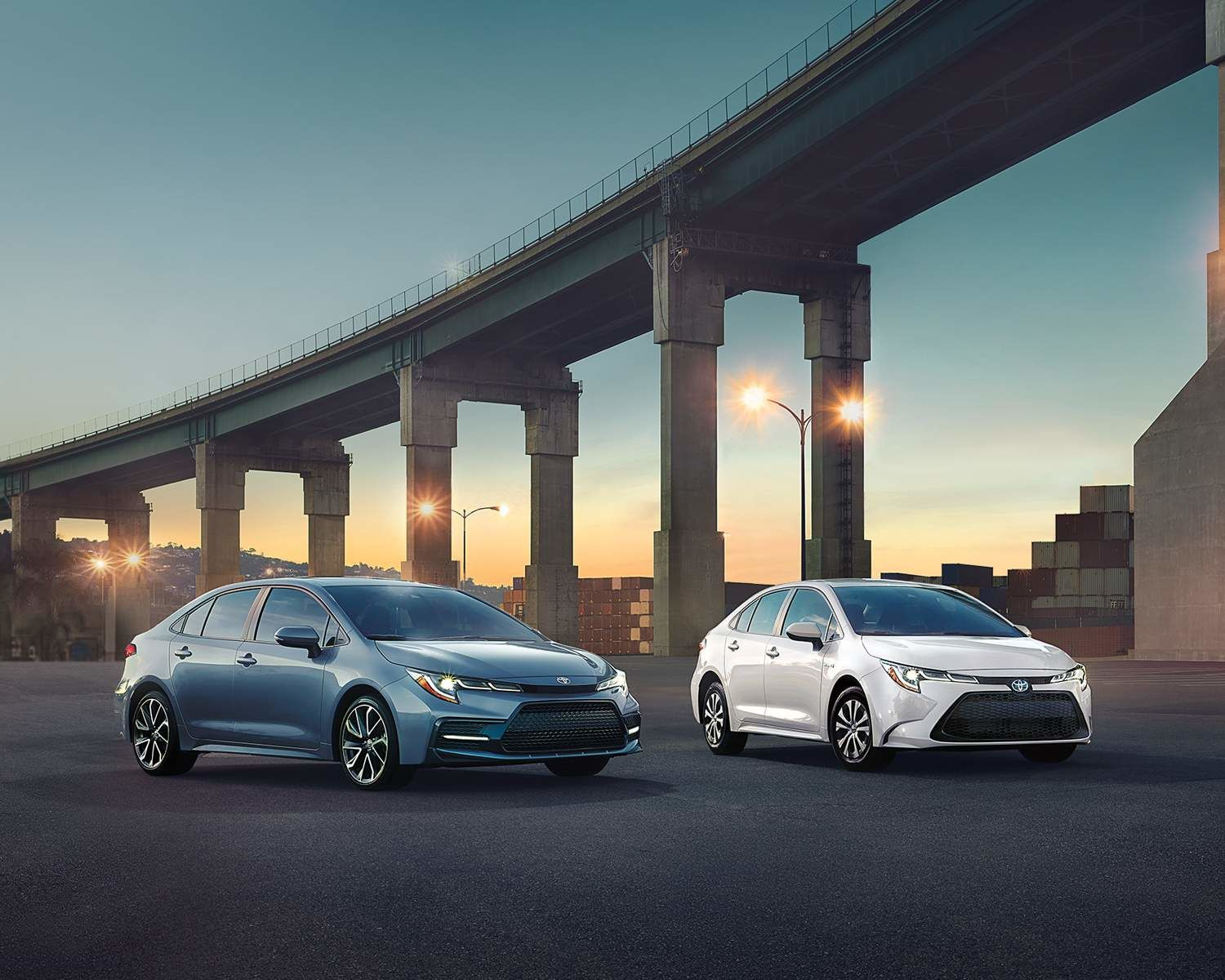 2021 Corolla's by a bridge in a city at dusk