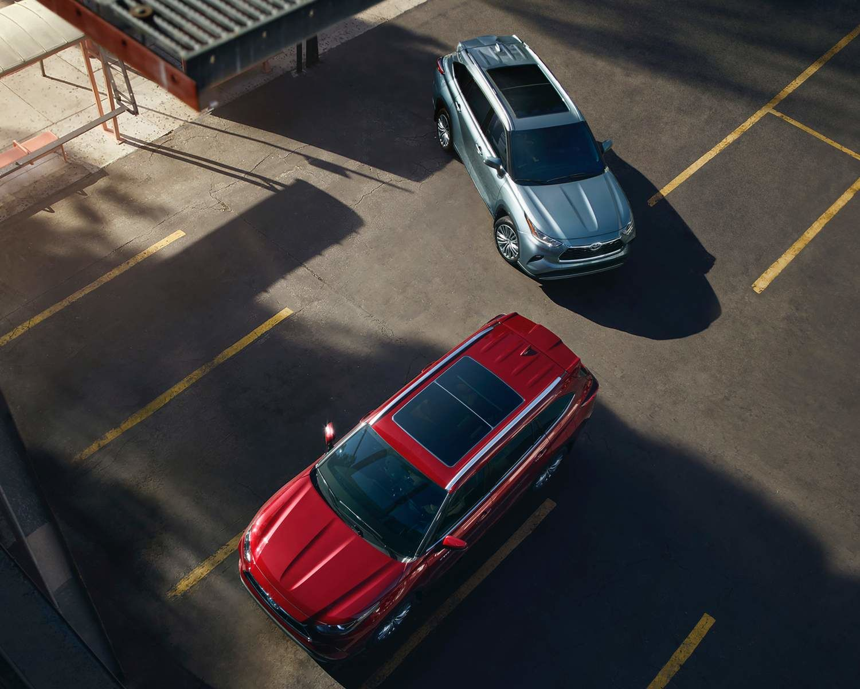 Highlander Hybrid shown in Ruby Red Pearl & Highlander Platinum shown in Moondust