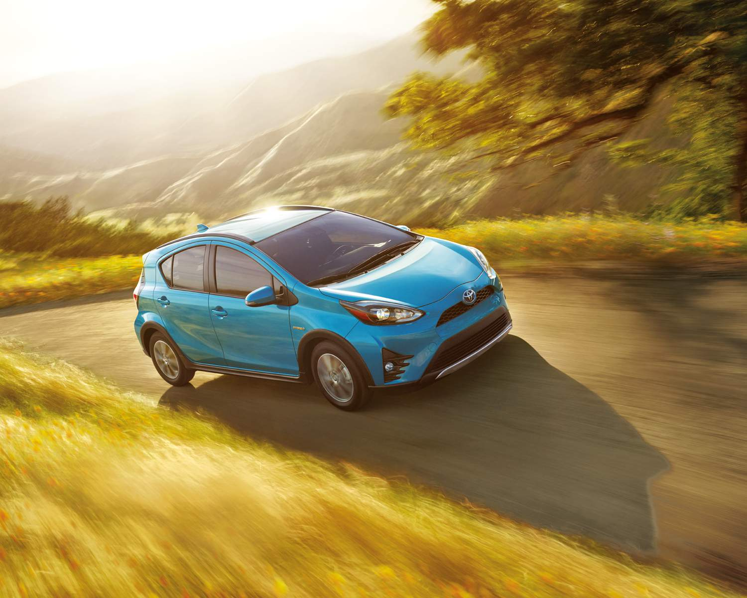 Prius c Technology shown in Clear Emerald Pearl