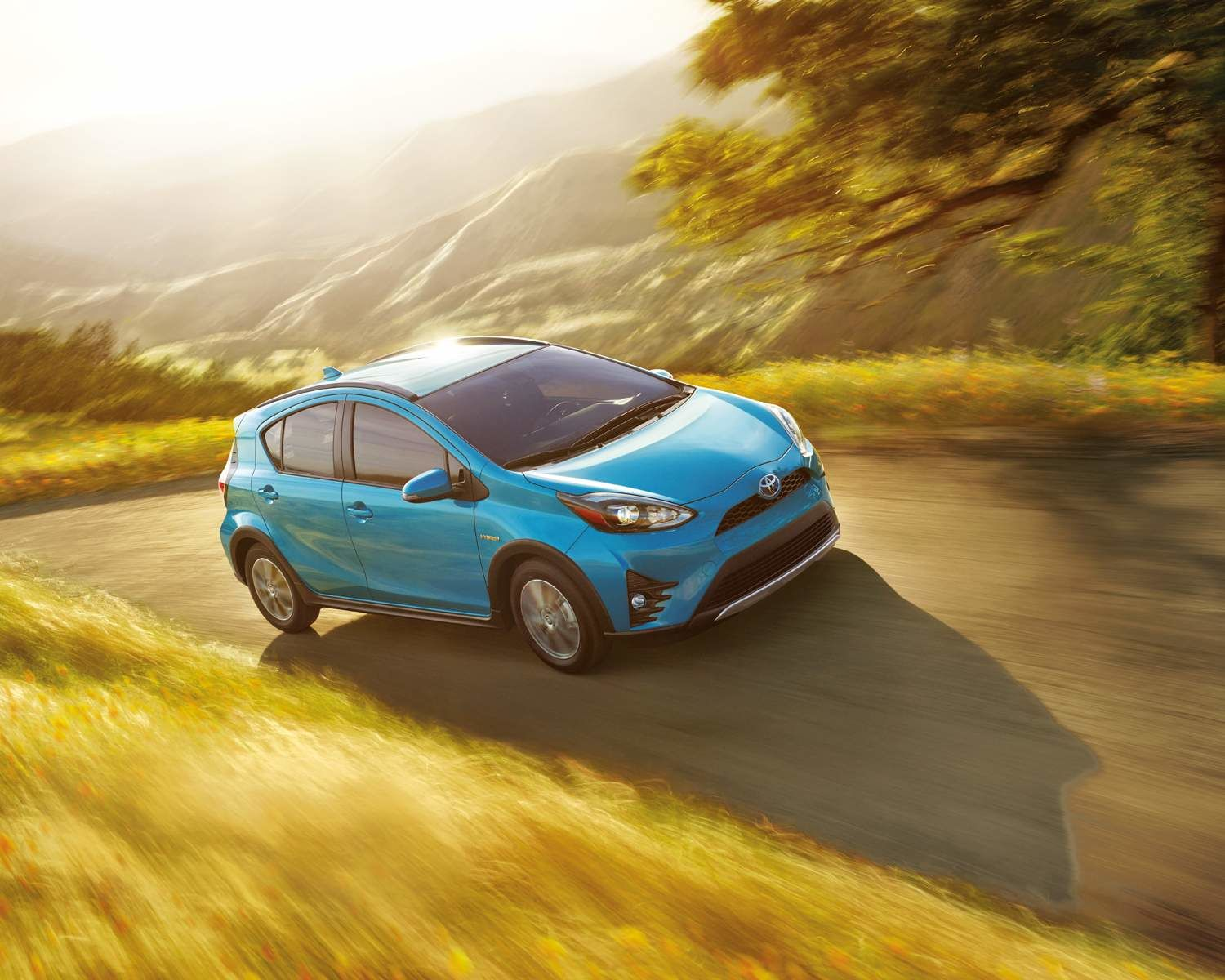 Prius c shown in Clear Emerald Pearl