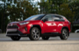 RAV4 Prime shown in Supersonic Red with Black Roof