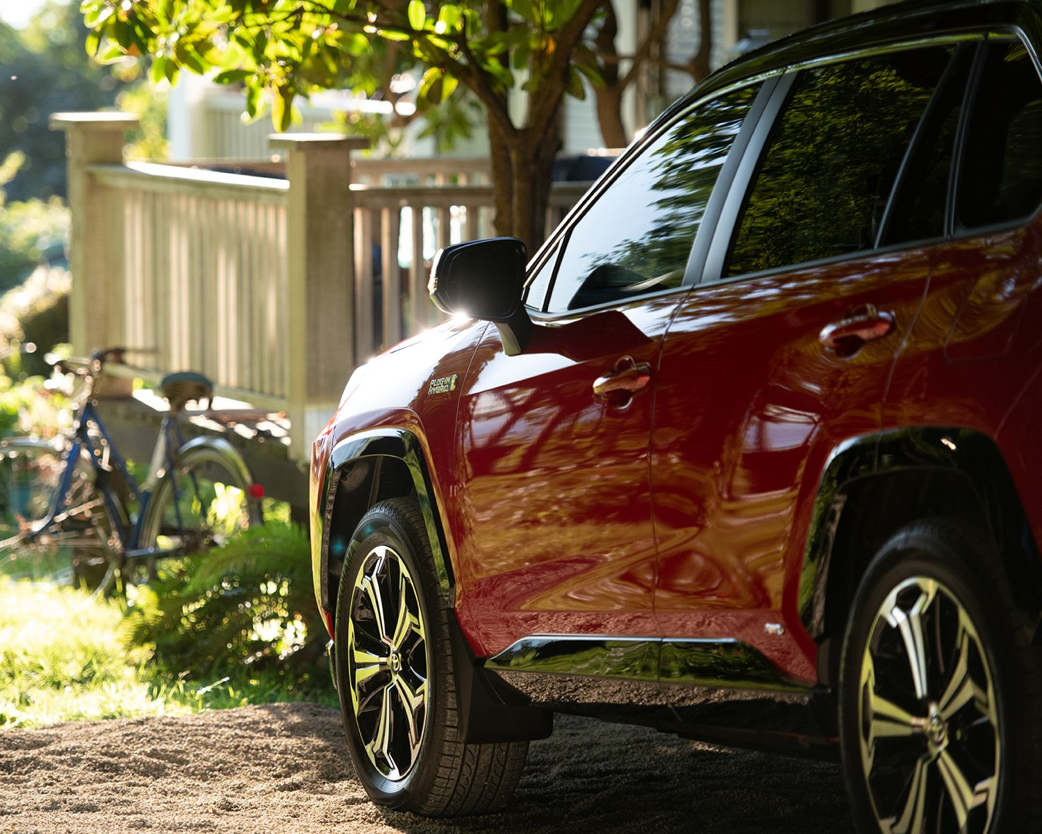 RAV4 Prime XSE AWD shown in Supersonic Red with Black Roof