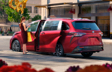 Sienna XSE with Kick Sensor shown in Ruby Flare Pearl