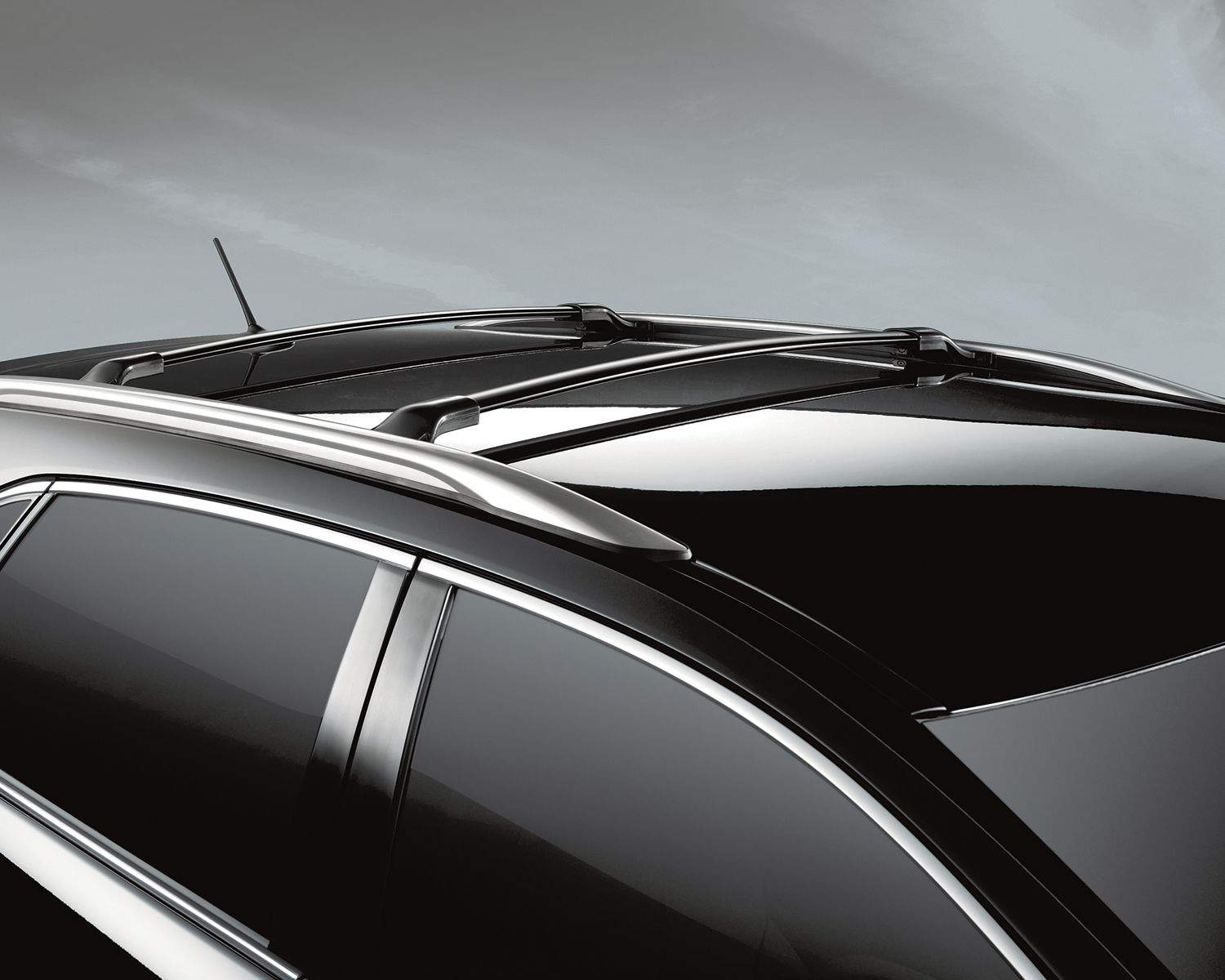 Venza in Midnight Black Metallic with Accessory Roof Rack