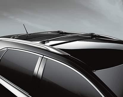 Venza montrée en Noir minuit métallisé avec porte-bagages de toit