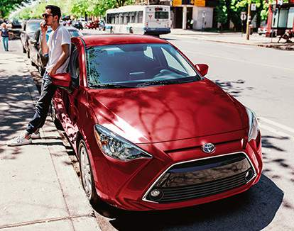 Yaris Sedan Premium shown in Pulse Red Metallic