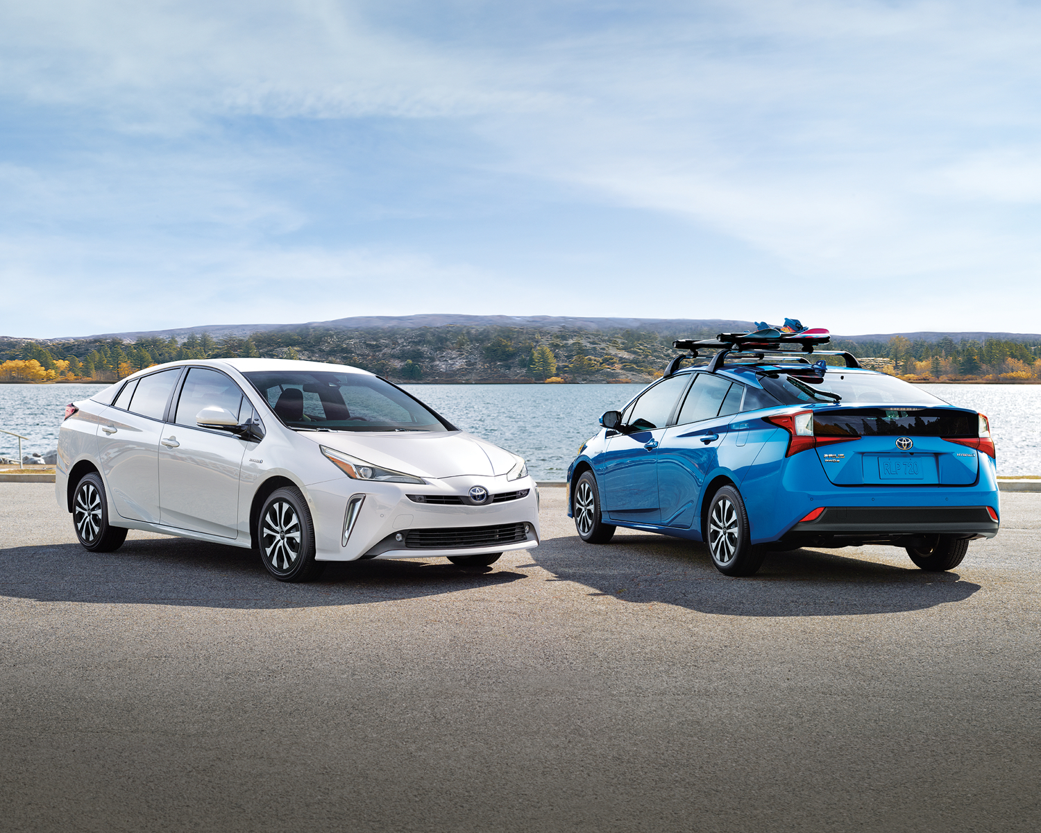 Prius Technology AWD-e shown in Electric Storm Blue and Super White