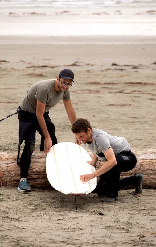 Pete Devries teaching Michael how to surf in Tofino, BC