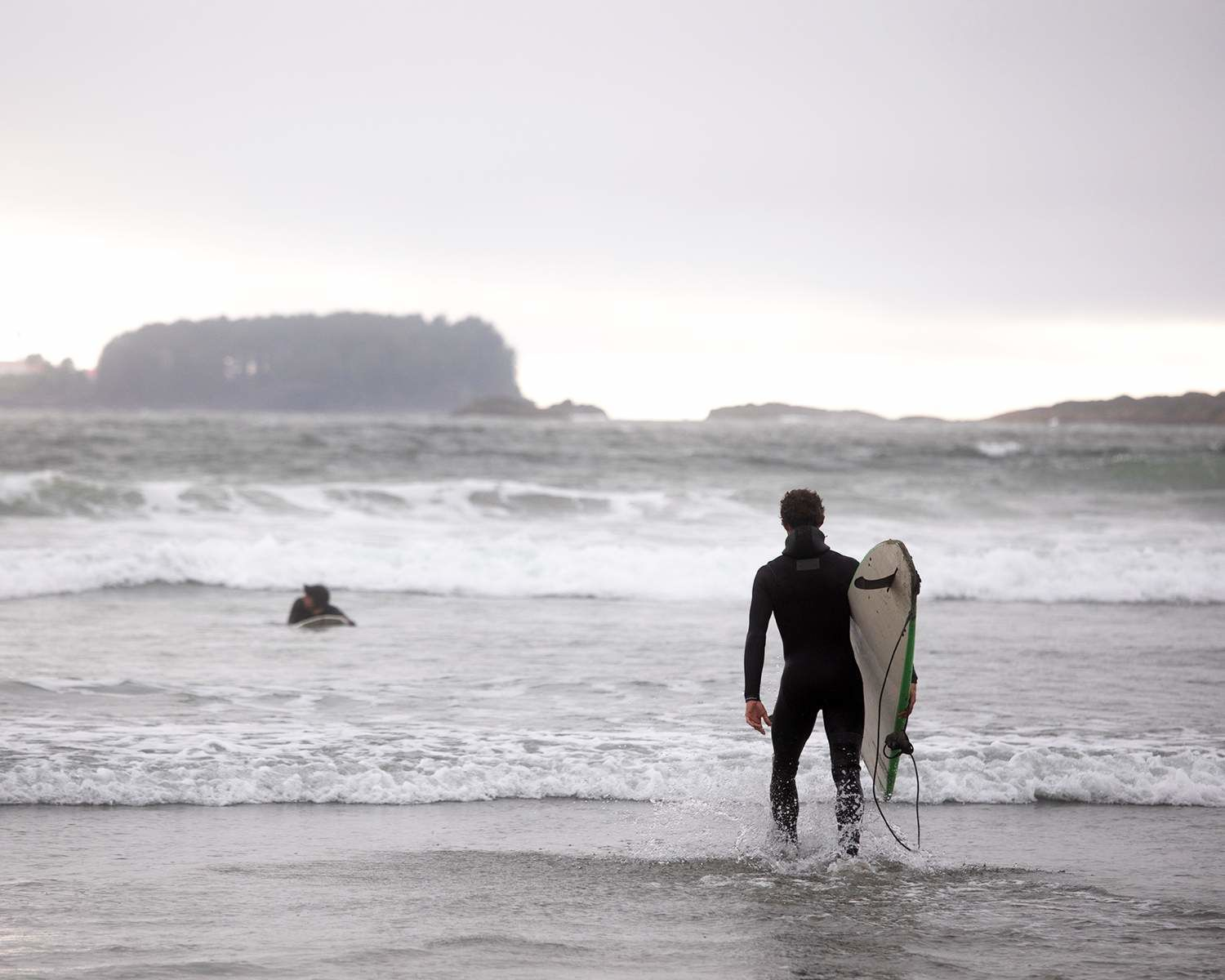 Michael and Pete Devries surfing in Tofino, BC