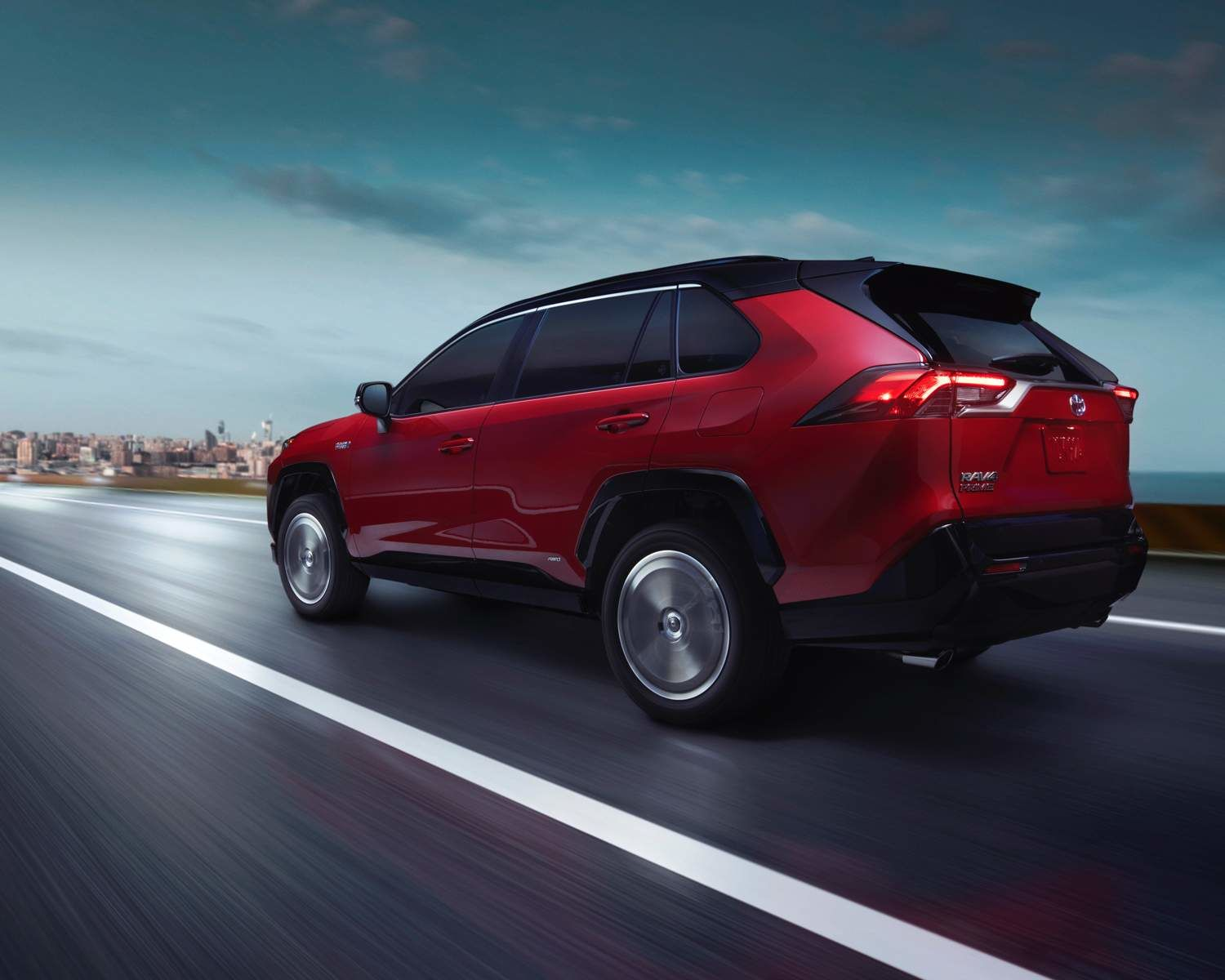 RAV4Prime XSE shown in Supersonic Red with Black Roof