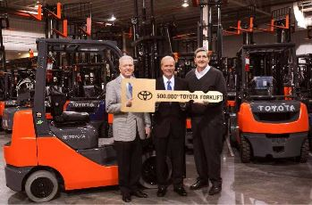 TMHU President, Jeff Rufener, TMHNA President & CEO, Brett Wood and TMHU VP Sales & Marketing, Bob Bosworth hold the key to Toyota's 500,000th forklift made in the USA.
